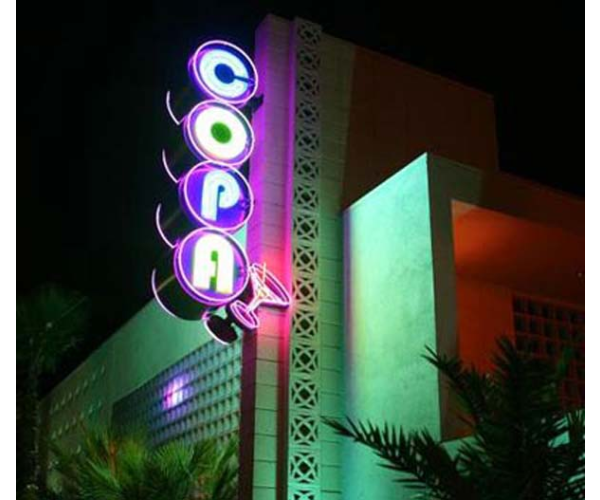 large Custom neon sign on side of building for copa bar