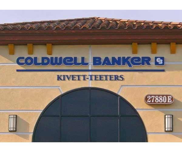 Backlit lettirng and logo sign mounted on building face for Coldwell Banker
