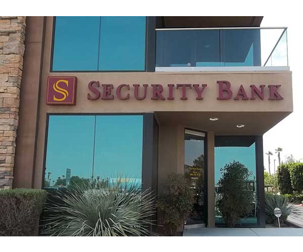 Security Bank gemini lettering and logo on side of building