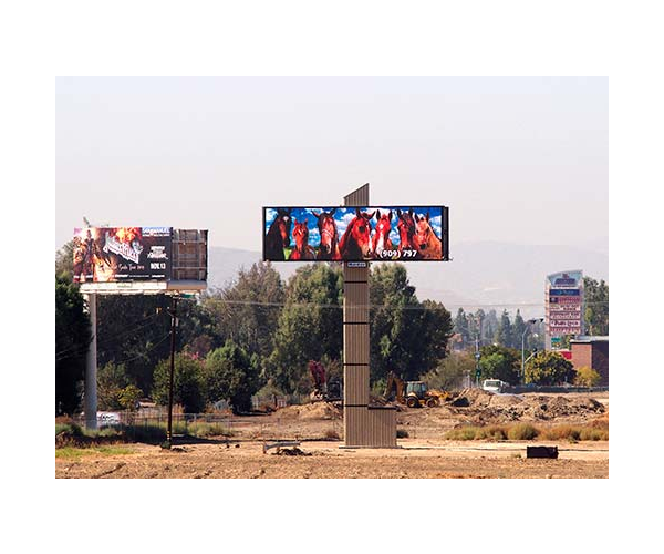 large illuminated LED billboard seen from freeway