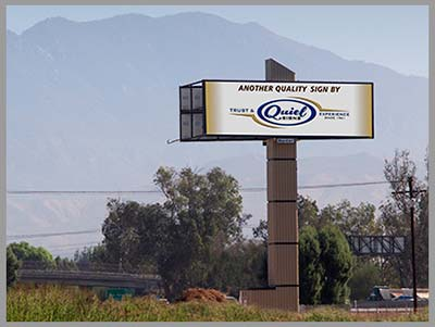 large LED billboard illuminated with Quiel Logo