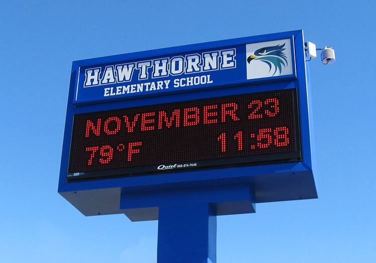 blue LED school marquee sign against blue sky