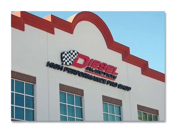 custom backlit channel lettering and logo on side of building