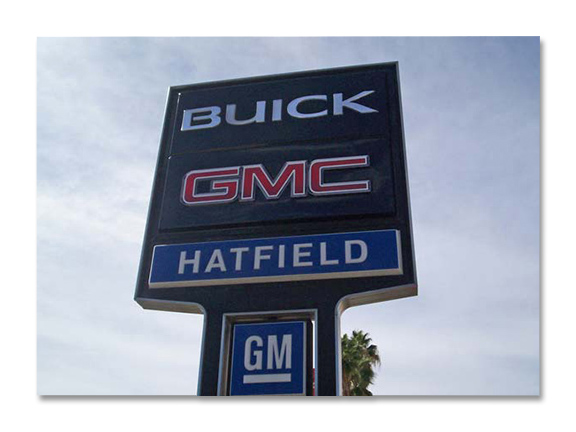 car dealership sign against cloudy sky for Buick GMC Hatfeild