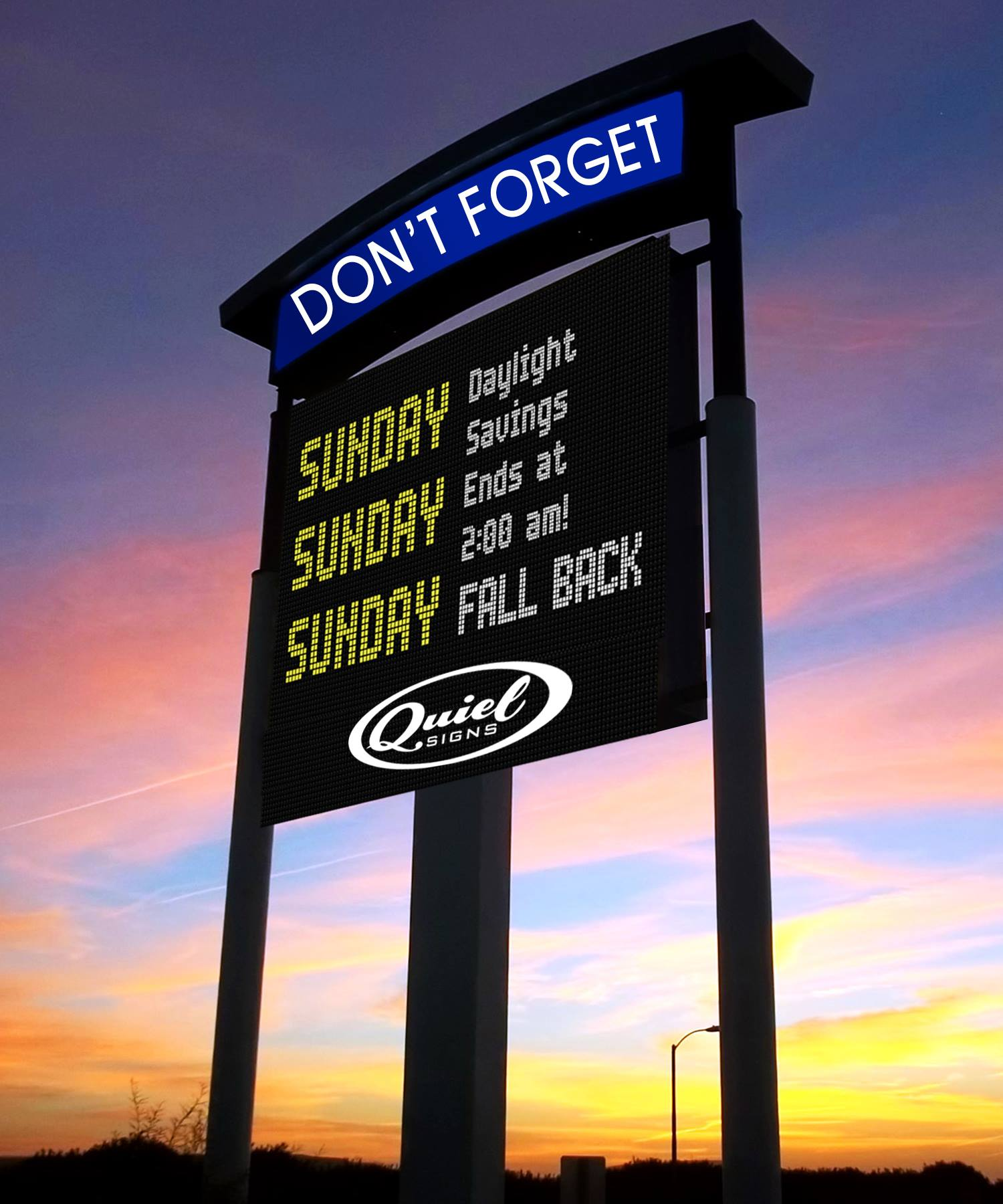 tall LED sign against sunset background